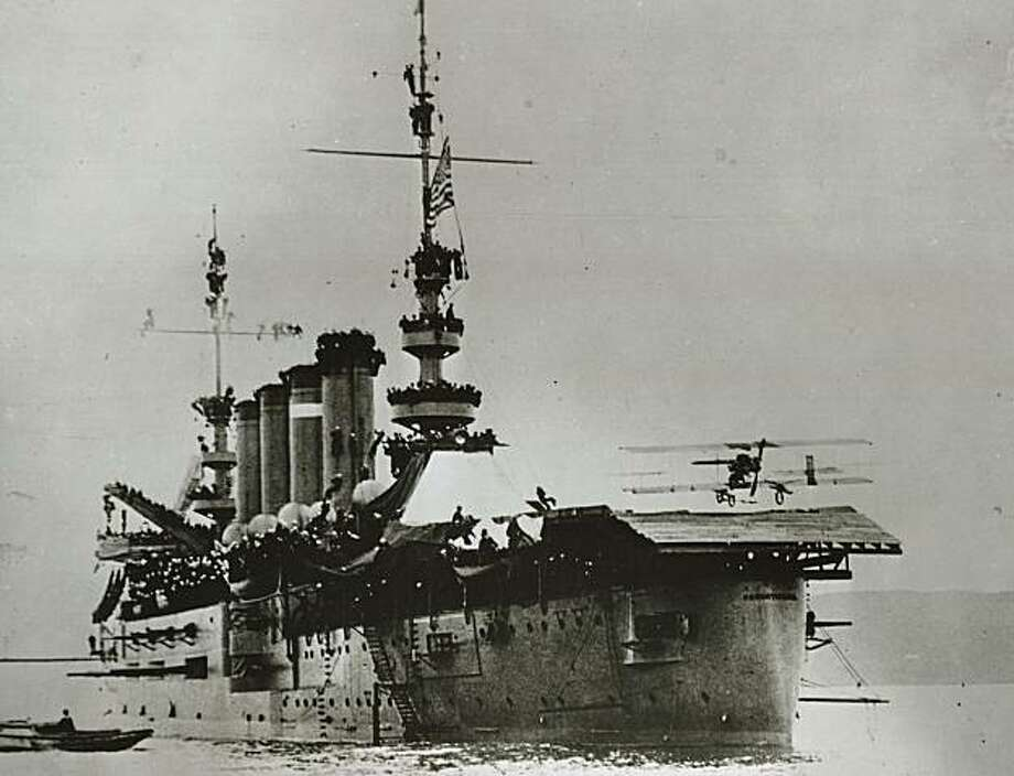 Carrier17a.JPG Eugene Ely lands his pusher-type Curtiss airplane onto the armored cruiser USS Pennsylvania in San Francisco Bay, Jan. 18, 1911. Chronicle Archive/San Francisco Chronicle Photo: Chronicle Archive, San Francisco Chronicle