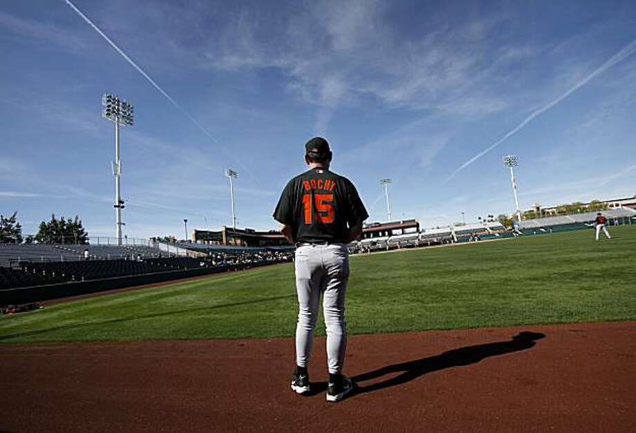 San Francisco Giants manager Bruce Bochy watched his team practice from the warning track in right field at Scottsdale Stadium Friday February 26, 2010. Photo: Brant Ward, The Chronicle