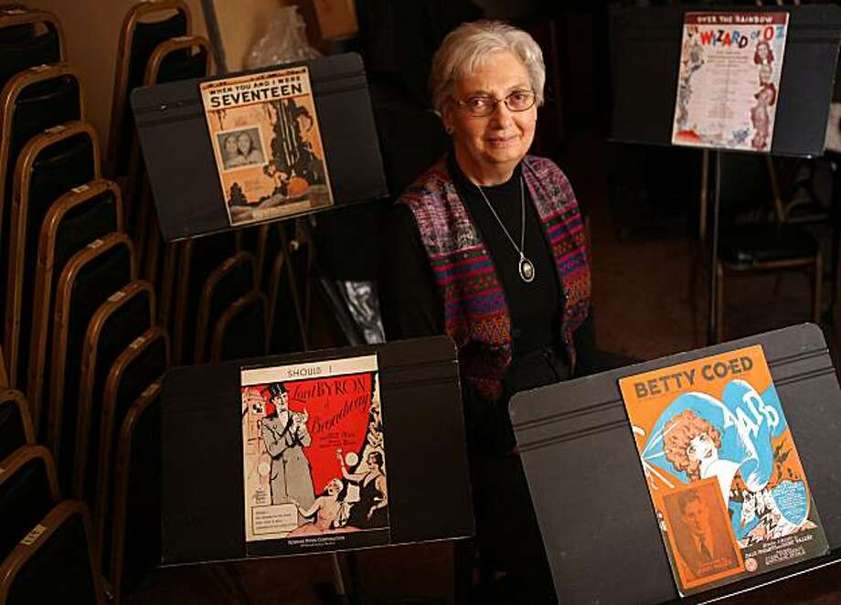 Jean Cunningham who runs the Paramount Theatre Music Library next to vintage music sheets in the basement of the Paramount theater in Oakland, Calif., on Wednesday, January 12, 2011.  The library houses one of the largest collections of sheet music in the country with 250,000 entries dating from the 1870s to the 1950s. Photo: Liz Hafalia, The Chronicle