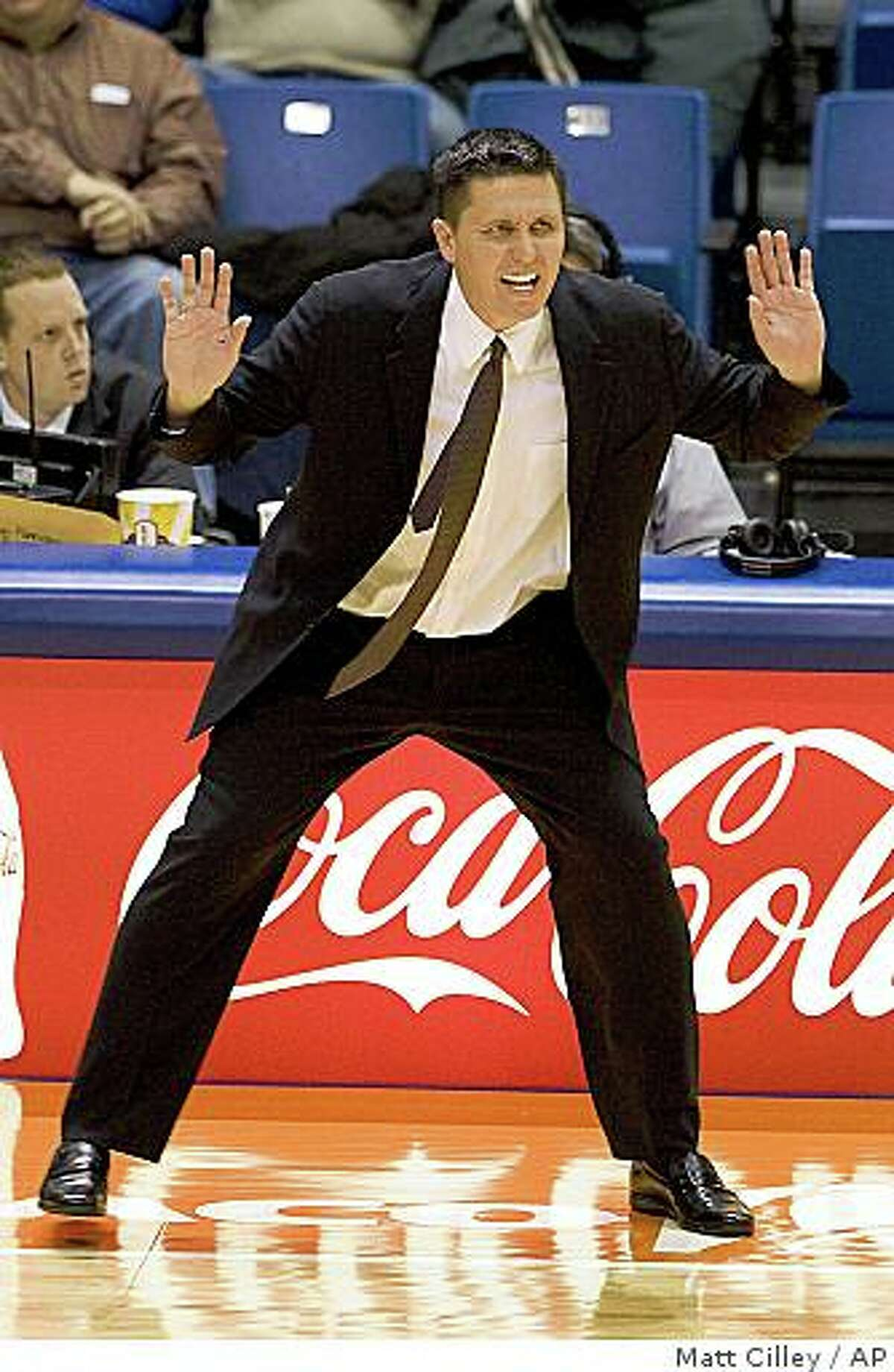 San Francisco head coach Rex Walters talks to his players as they play against Boise State during the first half of an NCAA college basketball game on Saturday, Dec. 13, 2008, in Boise, Idaho. (AP Photo/Matt Cilley)