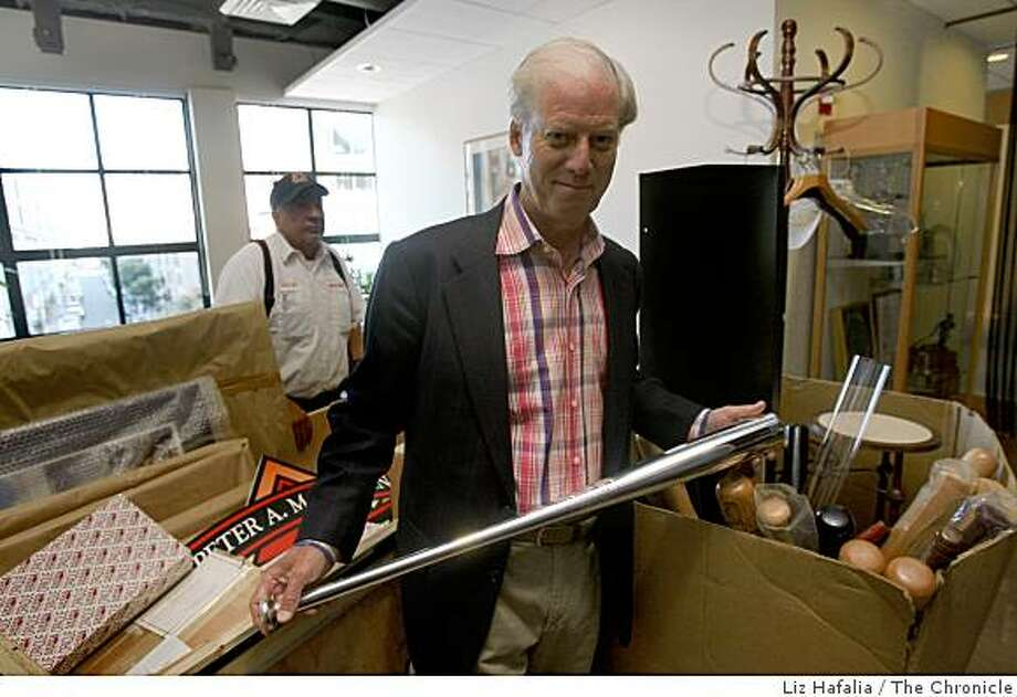Peter Magowan at the Giants executive offices shows a silver bat given to him by the Giants as he moves from his office on his final day as managing general partner in San Francisco,  Calif.,  on Tuesday, September 30, 2008. Photo: Liz Hafalia, The Chronicle