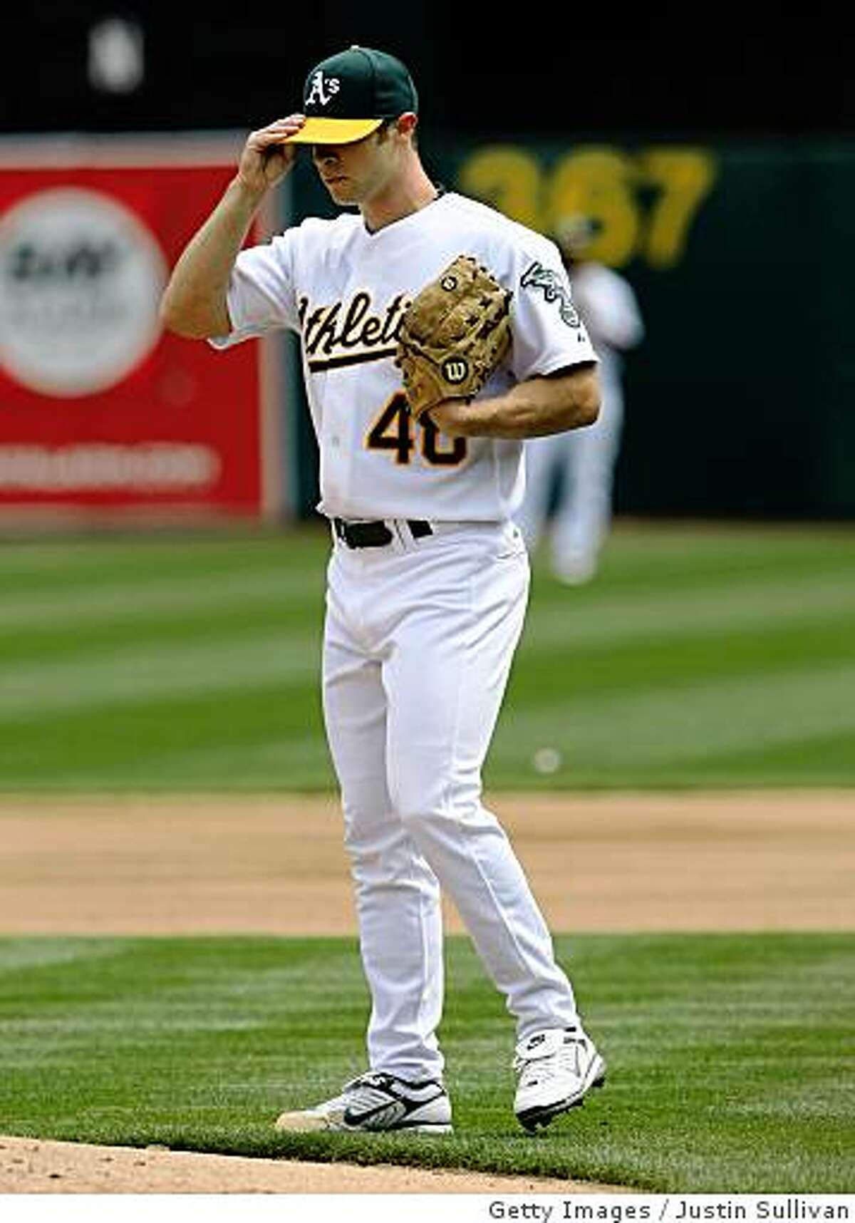 OAKLAND, CA - APRIL 02: Rich Harden #40 of the Oakland Athletics adjusts his hat as he pitches against the Boston Red Sox during the first inning at the McAfee Coliseum April 2, 2008 in Oakland, California. (Photo by Justin Sullivan/Getty Images)