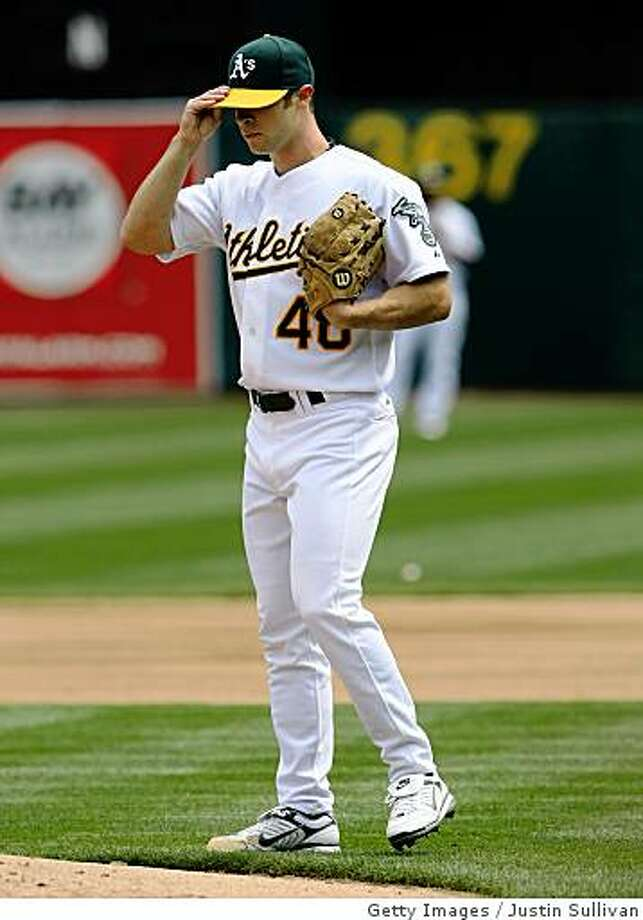 OAKLAND, CA - APRIL 02:  Rich Harden #40 of the Oakland Athletics adjusts his hat as he pitches against the Boston Red Sox during the first inning at the McAfee Coliseum April 2, 2008 in Oakland, California.  (Photo by Justin Sullivan/Getty Images) Photo: Getty Images