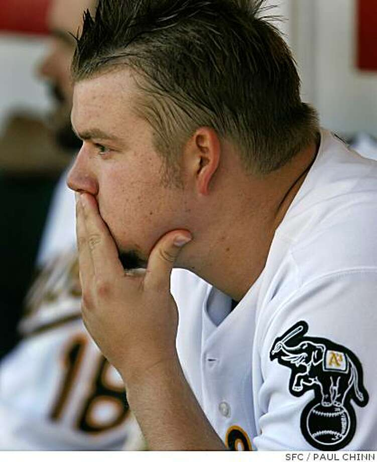 "Write bodyBy Susan SlusserChronicle Staff WriterOakland?s rotation now officially bears no relation to last year?s, with the last remnant, right-hander Joe Blanton, traded to Philadelphia on Thursday, nine days after the A?s sent Rich Harden to the Cubs.In exchange for Blanton, who is tied with the Giants? Barry Zito for the most losses in the majors, the A?s received three prospects, Class-A second baseman Adrian Cardenas and outfielder Matt Spencer, and left-hander Josh Outman, who was recently promoted to Double-A. ?I?m obviously shocked, anyone would be,"" Blanton told The Chronicle by phone from Nashville, where he spent part of the All-Star break. ""It?s one of those deals where it?s very bittersweet. I?m going to a very good team with a very good lineup. They?re in the division hunt and they?re out to win a championship, and that?s what any player wants. But I?ve always been with the A?s, and I have great relationships there. It?s one of those double-sided coins.""  The move clearly was made for the future, with such lower-level prospects, and coming as it does on the heel of the Harden trade, it increases the level of difficulty for this year?s club to contend. ?I think this is just the direction everyone expected us to go in,?? said A?s closer Huston Street, who could be next up on the trading block. ?We played a great first half, better than anyone expected, but it?s pretty clear we?re going younger, younger, younger.??The A?s got six young players in the Dan Haren deal in December, three in the Nick Swisher deal, two in the Mark Kotsay trade and three in the deal that sent Harden and Chad Gaudin (another member of last year?s rotation) to Chicago last week.?We started this process last November and said we wanted to build a foundation of young players who will be here a long time,?? A?s assistant general manager David Forst said. ?We want to create what we did at the beginning of the decade, a team that continually gets better.?? Forst said the A? Photo: PAUL CHINN, SFC"
