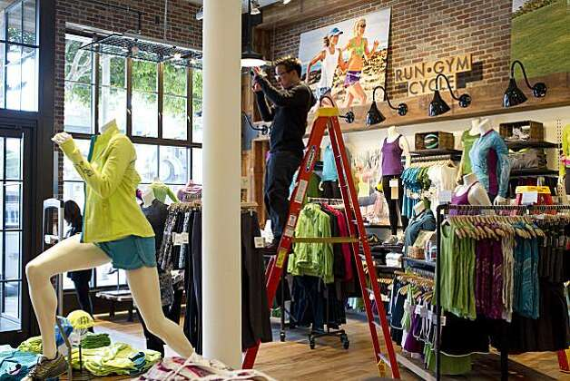 Bart Chin snaps a photo of the interior of the new Athleta store on Fillmore Street in San Francisco, Calif., on Wednesday, January 12, 2011.  The company, owned by Gap, is trying to transition from a former e-commerce brand into a brick and mortar store. Photo: Laura Morton, Special To The Chronicle