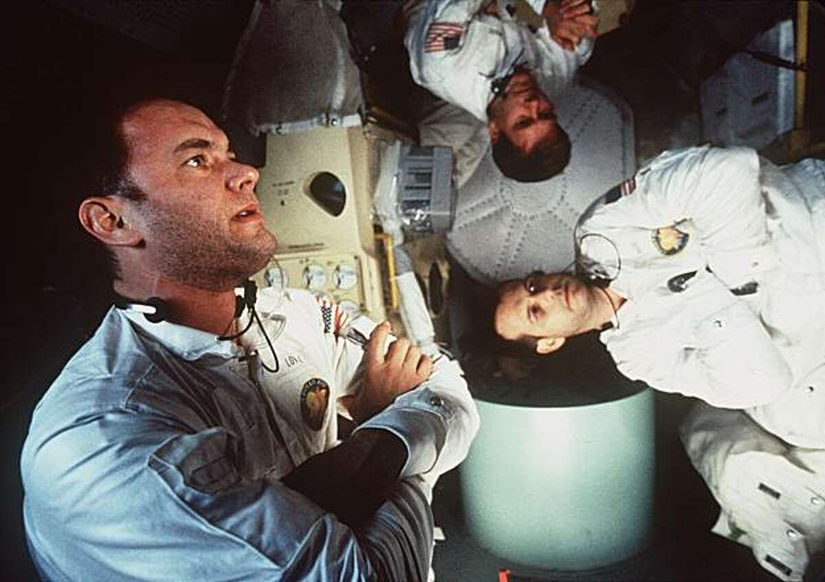 Tom Hanks, left, Kevin Bacon, center, and Bill Paxton appear in character in Universal Pictures