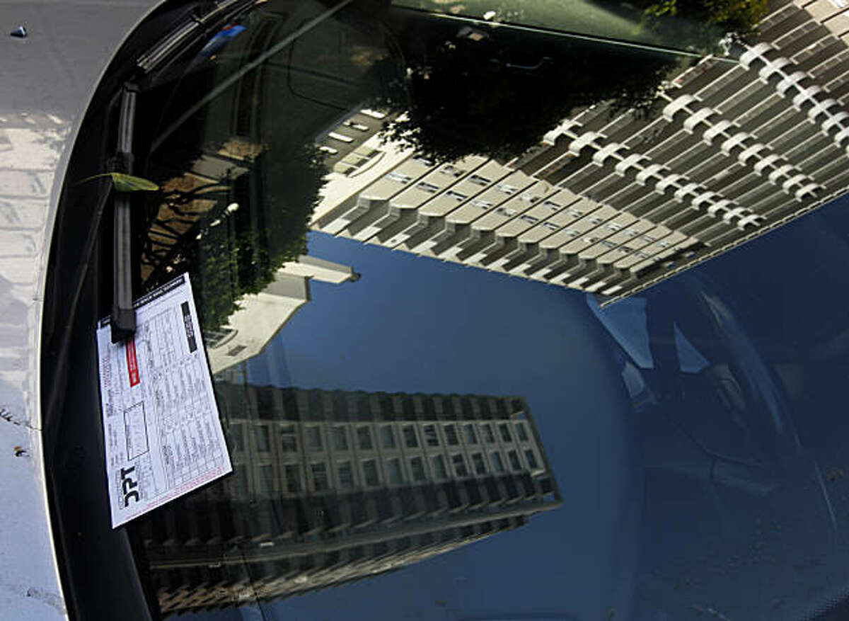 A parking ticket is left on the windshield of a car parked at an expired meter on Washington Street in San Francisco, Calif., on Wednesday, Oct. 6, 2010.