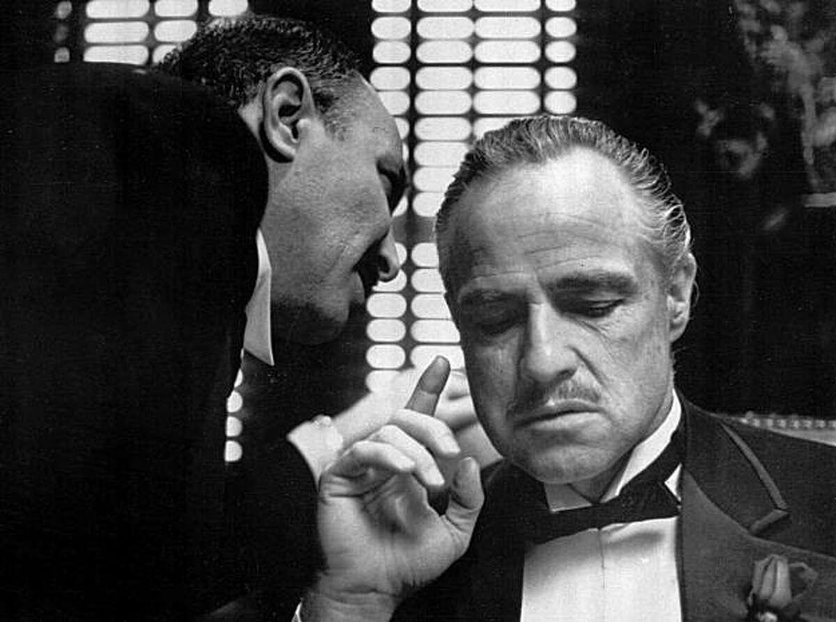 Frank Puglia as Bonasera and Marlon Brando as Don Vito Corleone in