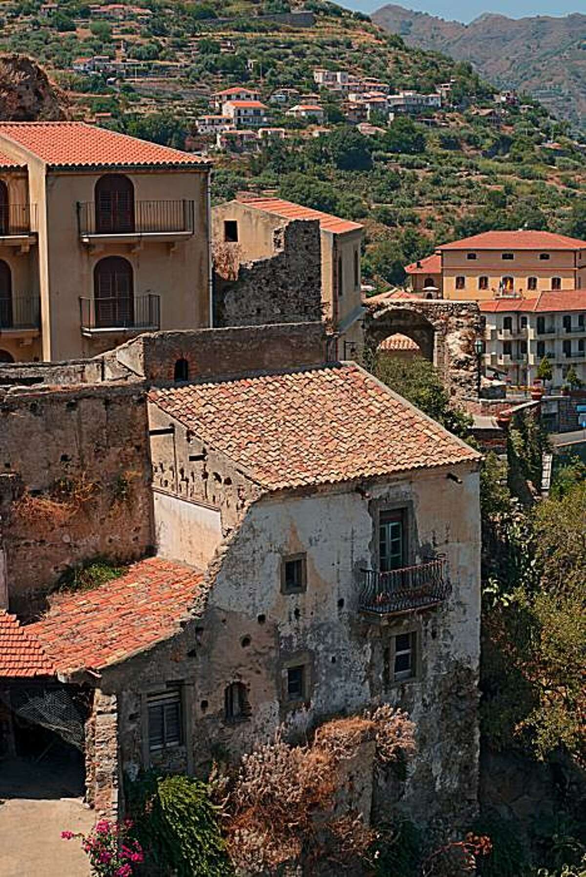 Old weathered homes adorn the postcard-perfect hillside of Savoca, Sicily.