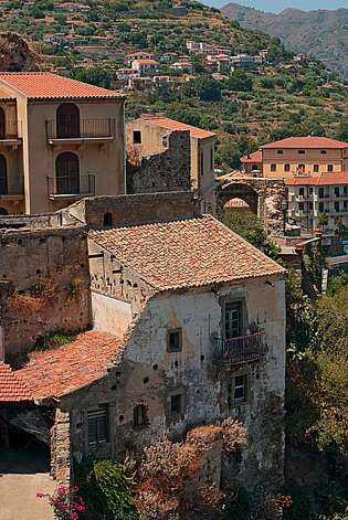 Old weathered homes adorn the postcard-perfect hillside of Savoca, Sicily. Photo: Chris Hardy, Special To The Chronicle