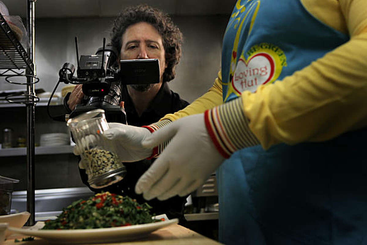 Directors James Ehrlich films the making of a salad at the Loving Hut, for the Hippie Gourmet cooking video, TUesday Dec. 21, 2010, in Palo Alto, Calif.