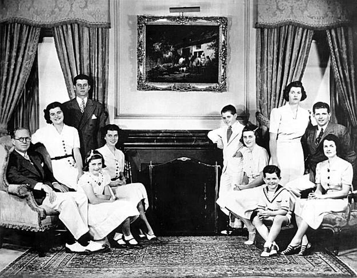 (FILES) A file photo taken 10 December 1937 in Washington shows the Kennedy family posing for photographers. (From L) Joseph Kennedy, his wife Rose and their children Patricia, John, Jean, Eunice, Robert, Katheleen, Edward, Rosemary (R, standing) and Joseph Jr. Eunice Kennedy Shriver, sister of slain US president John F. Kennedy and founder of the Special Olympics, died August 11, 2009 in Massachusetts, her family said. She was 88.