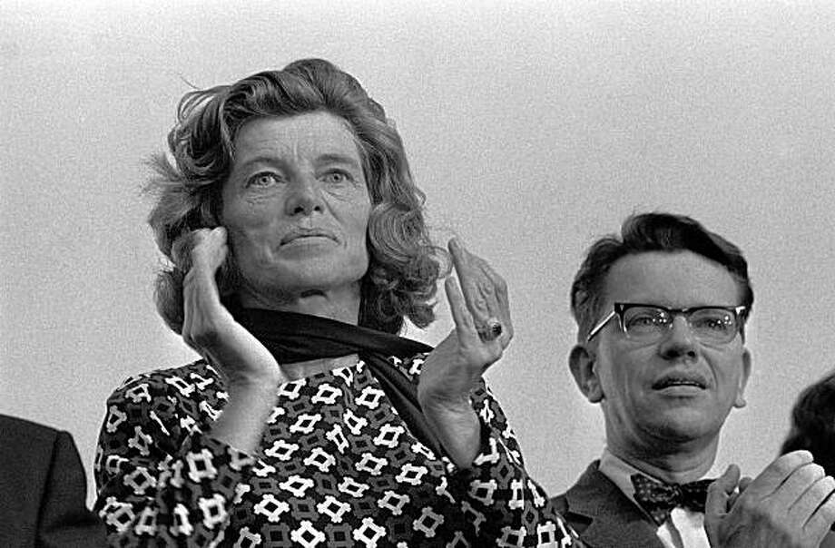 FILE - In this Aug. 13, 1970  file photo, Eunice Shriver, left, and Illinois lieutenant-Governor Paul Simon watch as participating members of the International Special Olympics parade at Soldier Field in Chicago.   Shriver, JFK's sister and Special Olympics founder, has died at age 88. (AP Photo/Fred Jewell, File) Photo: Fred Jewell, AP