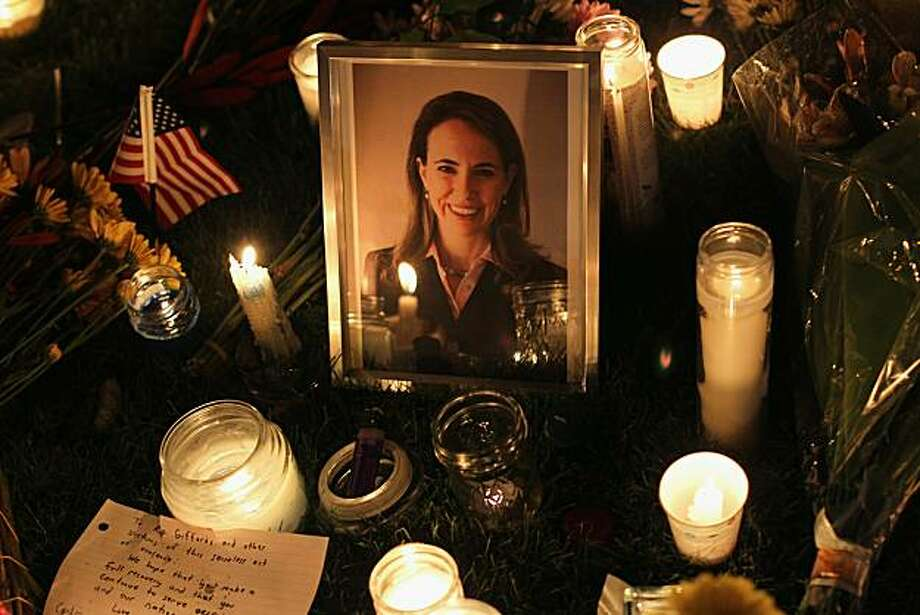 "TUCSON, AZ - JANUARY 08:  Candles surround a portrait of U.S. Rep. Gabrielle Giffords (D-AZ), who was shot January 8, 2011 in Tuscon, Arizona. Giffords was shot in the head at a public event entitled ""Congress on Your Corner"" when a gunman opened fire outside a Safeway grocery store in Tucson. It was reported that eighteen people were shot, including members of Giffords' staff, and six are dead, including one young child. One suspect is in custody. Photo: John Moore, Getty Images"