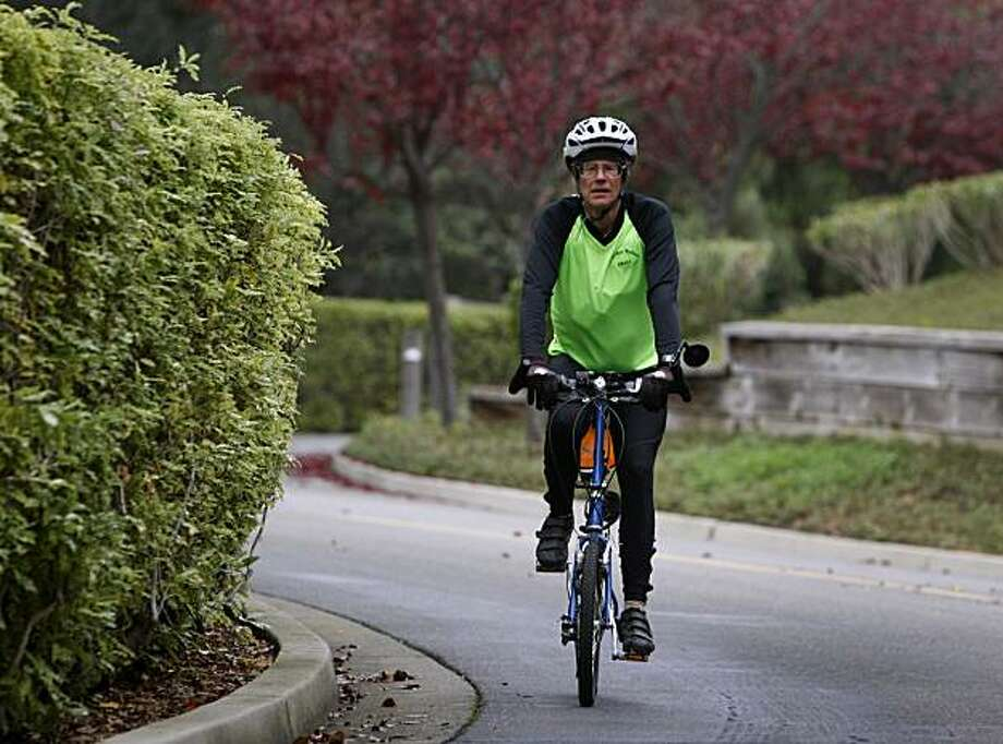 Charles Parrish rides his folding bicycle through the streets of Blackhawk in Danville, Calif., on Saturday, Dec. 11, 2010. Photo: Paul Chinn, The Chronicle