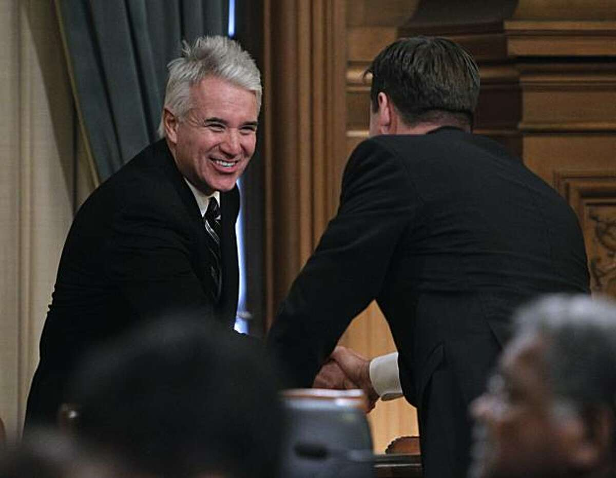 Police Chief George Gascon meets incoming Supervisor Mark Farrell before Farrell is sworn in at City Hall in San Francisco on Saturday. In one of his last acts as mayor, Gavin Newsom may pick Gascon as the new District Attorney to replace Kamala Harris.