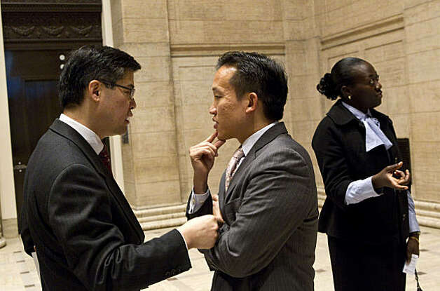 Asian Art Museum Director Jay Xu (left) speaks with Supervisor David Chiu after a press conference to disucss the museum's finances in San Francisco, Calif., on Thursday, January 6, 2011. Photo: Laura Morton, Special To The Chronicle