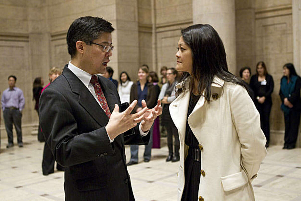 Asian Art Museum Director Jay Xu speaks with San Francisco Supervisor Carmen Chu before a press conference to discuss the museum's financial situation at the museum in San Francisco, Calif., on Thursday, January 6, 2011.