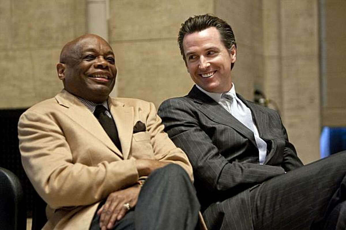 Former San Francisco Mayor Willie Brown (left) talks with San Francisco Mayor Gavin Newsom during a press conference to discuss the financial status of the Asian Art Museum at the museum in San Francisco, Calif., on Thursday, January 6, 2011.
