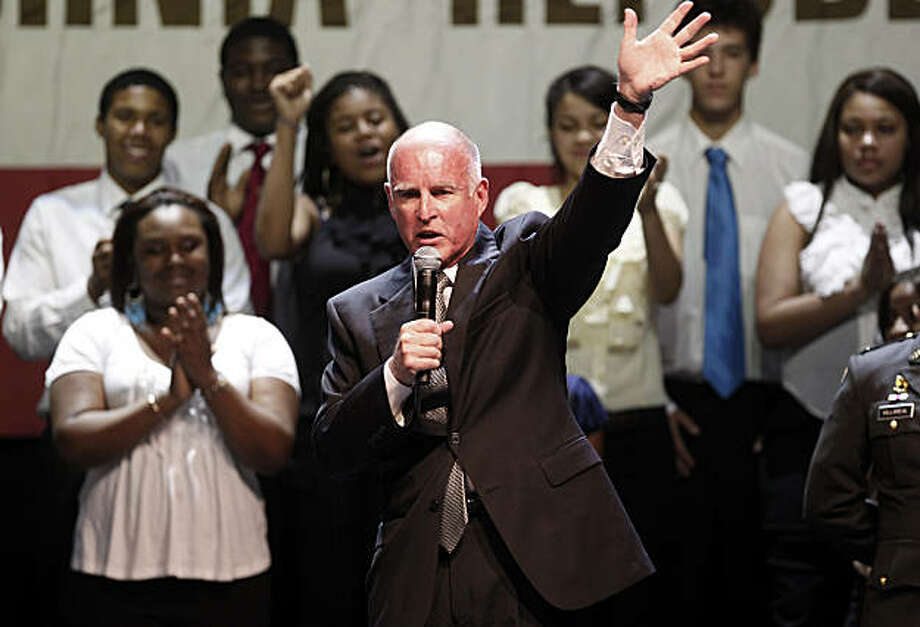 Jerry Brown waved to the crowd of supporters with members of the Oakland School for the Arts in the background. Governor-elect Jerry Brown addressed supporters at the Fox Theatre in downtown Oakland, Calif. Tuesday November 2, 2010. Photo: Brant Ward, The Chronicle