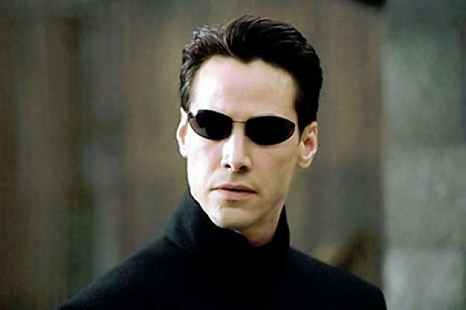 Q: Fashion Week or Halloween Costume?A: Neo in The Matrix Reloaded Photo: Courtesy Warner Bros.