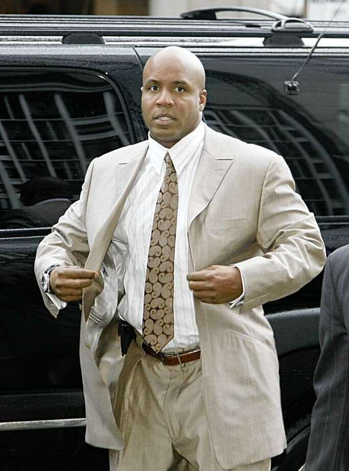 FILE - In this Feb. 5, 2009, file photo, Barry Bonds buttons his jacket after arriving to enter a plea at the Federal building in San Francisco. Federal prosecutors are urging an appellate court to let them present critical evidence they say proves Barry Bonds knowingly used steroids. A trial court judge excluded urine samples and other evidence from the upcoming trial of the San Francisco Giants slugger, who is accused of making false statements to a grand jury and obstructing justice. The judge says that evidence connected to Bonds' personal trainer Greg Anderson could only be used if Anderson testifies. Anderson says he'd rather go to jail than testify.(AP Photo/Eric Risberg, File) Photo: Eric Risberg, AP
