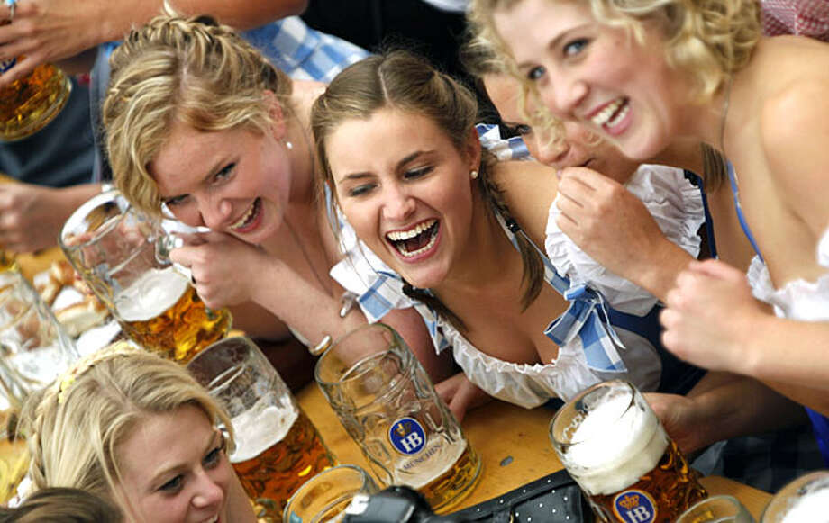 Young women laugh with beer steins in their hands after the opening of the Oktoberfest beer festival in Munich, southern Germany, Saturday, Sept. 18, 2010. People from around the world are expected to the biggest and most famous beer festival Oktoberfestwhich runs from Sept. 18 until Oct. 4 and marks its 200th anniversary this year. Photo: Matthias Schrader, AP