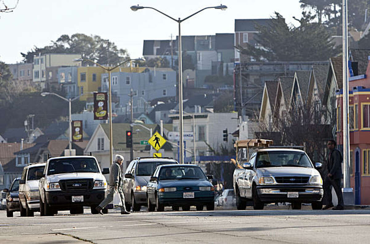 Motorists wait at a stoplight along Cesar Chavez Street in San Francisco, Calif., on Thursday, January 6, 2011. The city has unveiled a plan to remake the street with fewer traffic lanes, a new pedestrian plaza and new medium plantings.