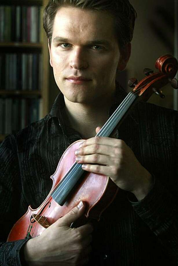 Mads Tolling, a Danish fiddle prodigy who's won two Grammys as a member of Turtle Island String Quartet holds his instrument in Albany, Calif., on Wednesday January 28, 2009. Photo: Mark Costantini, The Chronicle