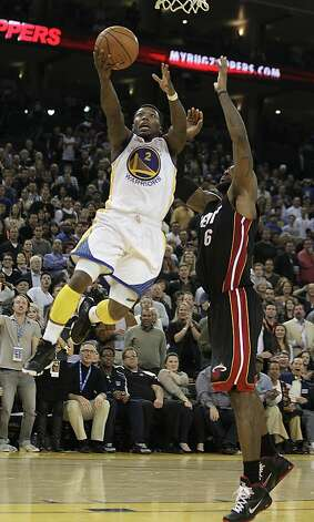 Golden State Warriors' Nate Robinson (2) lays up a shot over Miami Heat's LeBron James during second half action of an NBA basketball game Tuesday, Jan. 10, 2012, in Oakland, Calif. (AP Photo/Ben Margot) Photo: Ben Margot, Associated Press