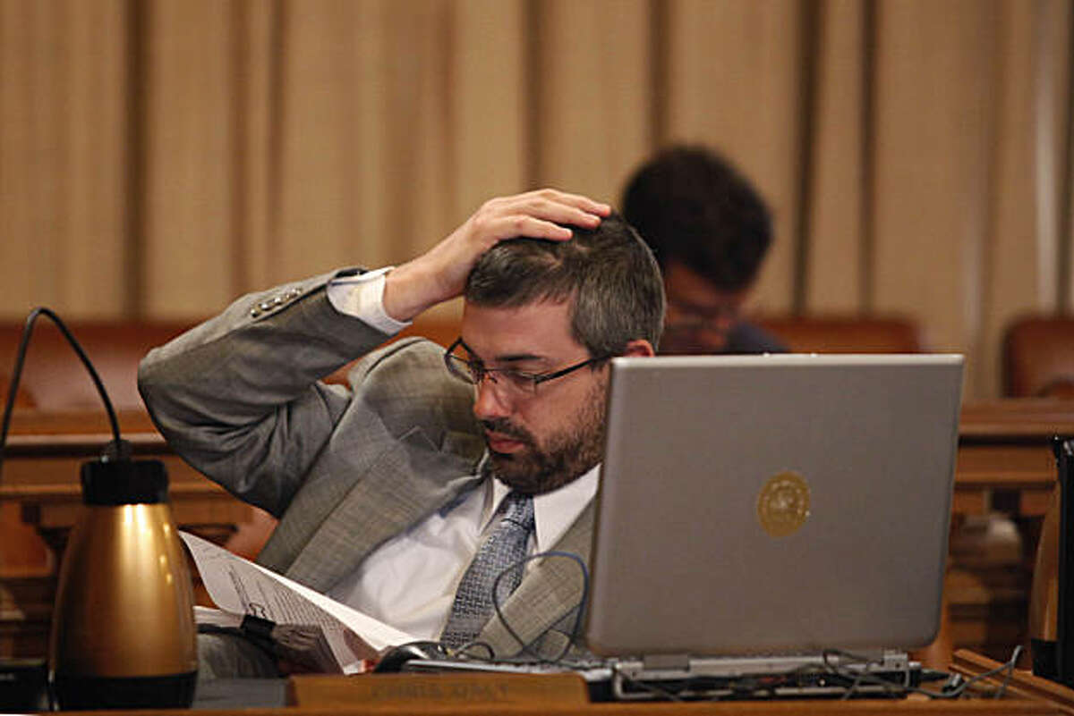 Supervisor Chris Daly studies paperwork during a San Francisco Board of Supervisors meeting at City Hall in San Francisco, Calif. on Tuesday May 4, 2010.