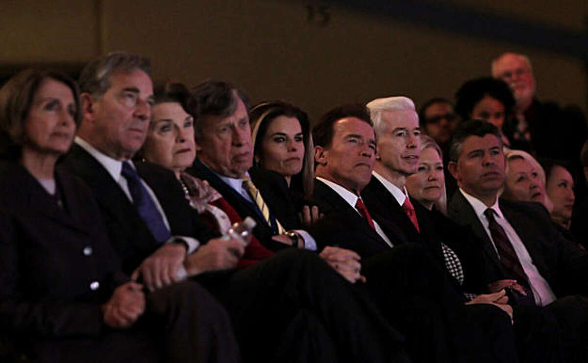 Arnold Schwarzenegger and his wife Maria Shriver sit with Gray Davis as they watch Jerry Brown take office as Governor of California, Monday, January 3, 2011, at the Memorial Auditorium in Sacramento, Calif.Arnold Schwarzenegger and his wife Maria ShriverArnold Schwarzenegger and his wife Maria Shriver sit with Gray Davis as they watch Jerry Brown take office as Governor of California, Monday January 3, 2011, at the Memorial Auditorium in Sacramento, Calif.