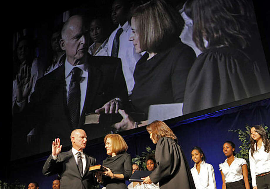 Governor-elect Jerry Brown with his wife Anne Gust Brown by his side is sworn in at Governor of California by Chief Justice Tani Cantil-Sakauye, Monday January 3, 2011, at the Memorial Auditorium in Sacramento, Calif. Photo: Lacy Atkins, The Chronicle