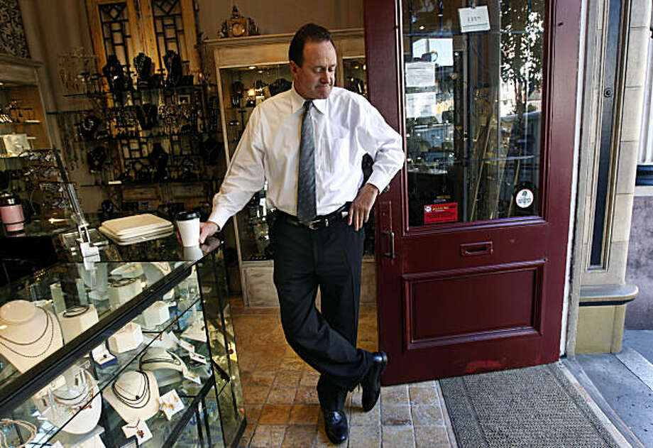Jeweler Bill Hoover stands in his Gallery of Jewels store in Noe Valley in San Francisco, Calif., on Wednesday, Jan. 5, 2011. Hoover received a letter from a disabled shopper complaining about the lack of accessibility for handicapped customers and demanding he complies with ADA requirements. Hoover is one of dozens of local merchants that have recently received letters from patrons or attorneys threatening lawsuits. Photo: Paul Chinn, The Chronicle