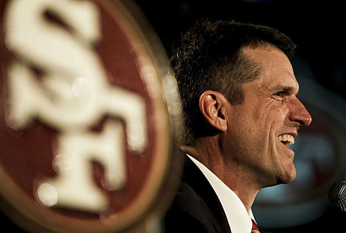 The San Francisco 49ers introduce their new head coach, Jim Harbaugh, at a news conference in San Francisco on Friday.