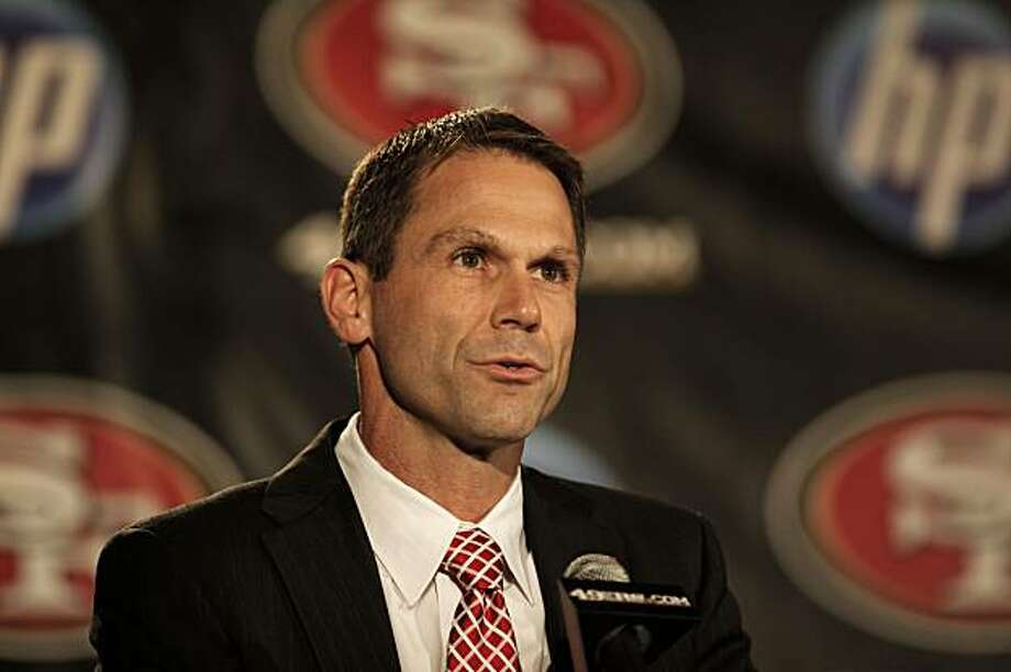 The San Francisco 49er team general manager Trent Baalke, introduces the new head coach of the team, Jim Harbaugh, during a news conference in San Francisco, Ca., on Friday Jan. 7, 2011. Photo: Michael Macor, The Chronicle