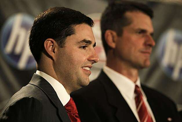 Jed York (left) introduces the 49ers' new head coach, Jim Harbaugh, at a news conference in San Francisco on Friday. Photo: Michael Macor, The Chronicle