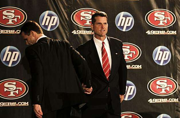 49ers GM Trent Baalke (left)  introduces Jim Harbaugh as the new head coach at a news conference in San Francisco on Friday. Photo: Michael Macor, The Chronicle