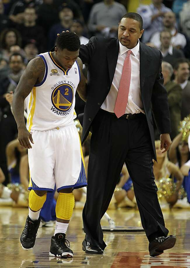 Golden State Warriors coach Mark Jackson, right, embraces Nate Robinson  during overtime of an NBA basketball game against the Miami Heat Tuesday, Jan. 10, 2012, in Oakland, Calif. (AP Photo/Ben Margot) Photo: Ben Margot, Associated Press