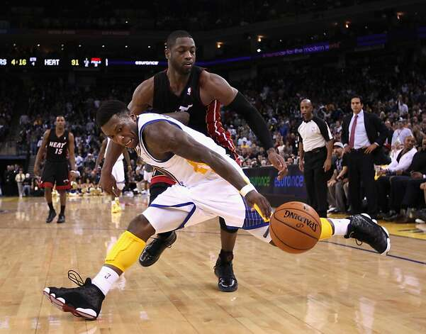 OAKLAND, CA - JANUARY 10:  Nate Robinson #2 of the Golden State Warriors loses the ball while guarded by Dwyane Wade #3 of the Miami Heat at Oracle Arena on January 10, 2012 in Oakland, California.  NOTE TO USER: User expressly acknowledges and agrees that, by downloading and or using this photograph, User is consenting to the terms and conditions of the Getty Images License Agreement.  (Photo by Ezra Shaw/Getty Images) Photo: Ezra Shaw, Getty Images