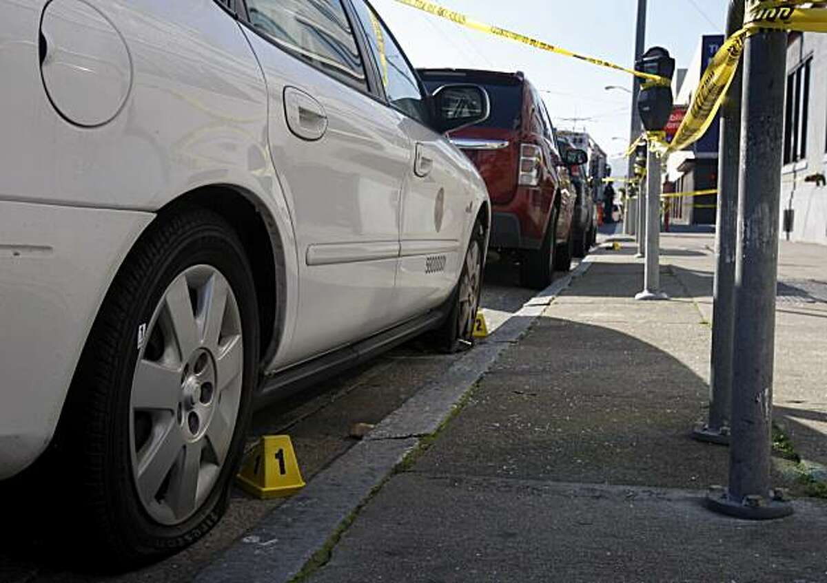A city-owned vehicle with two flat tires is protected by yellow tape while investigators gather evidence after police officers shot a man who reportedly threatened them with a knife in San Francisco, Calif., on Tuesday, Jan. 4, 2011. Witnesses say the man had earlier slashed the tires of several parked cars.
