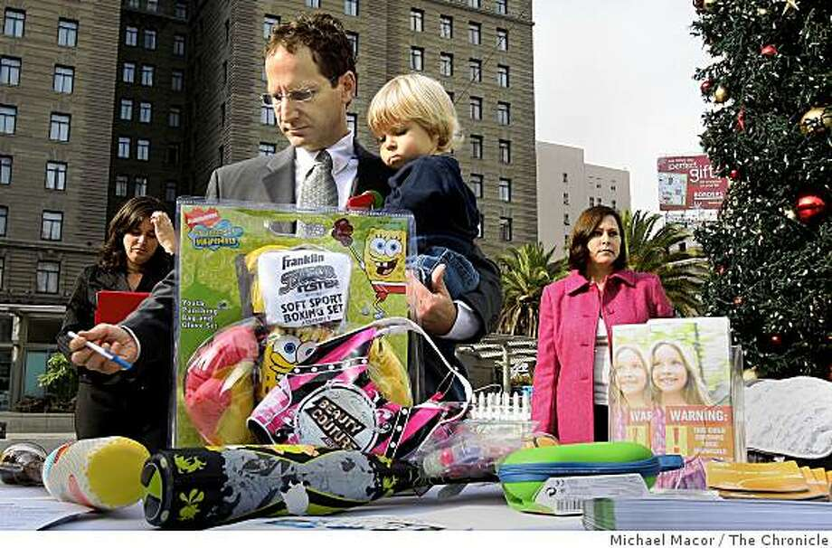 Executive Director, Michael Green, of the Oakland-based Center for Environmental Health, with his son Dylan, 2, displays some of the products with high lead levels are still on store shelves, Wednesday Dec.. 3, 2008 in San Francisco, Calif. Shoppers can visit the Oakland offices of the Center for Environmental Health at 2201 Broadway suite 302 in Oakland, Calif. to have their toys tested for toxic chemicals,  Monday-Thursday 12pm-6pm until Christmas Day, for free. Photo: Michael Macor, The Chronicle