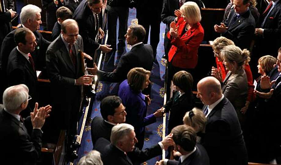 WASHINGTON, DC - JANUARY 05:  Speaker of the House John Boehner (R-OH) is congratulated by colleagues while entering the House chamber with outgoing Speaker of the House Nancy Pelosi (D-CA) following his election January 5, 2011 in Washington, DC.  The 112th U.S. Congress was sworn-in today, with Republican legislators taking control of the House of Representatives and expected to begin attempts to dismantle portions of U.S. President Barack Obama.s legislative agenda. Photo: Chip Somodevilla, Getty Images
