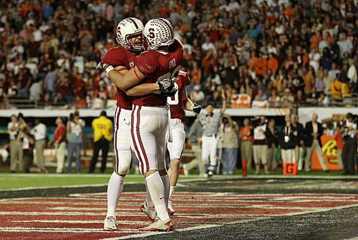 MIAMI, FL - JANUARY 03: (L-R) Coby Fleener #82 and Zach Ertz #86 of the Stanford Cardinal celebrate after Ertz scored a 25-yard touchdown reception in the second quarter against the Virginai Tech Hokies during the 2011 Discover Orange Bowl at Sun Life Stadium on January 3, 2011 in Miami, Florida.
