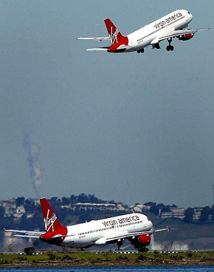 Virgin America airplanes take off from the San Francisco International Airport near Millbrae, Calif. on Tuesday March 10, 2009. Photo: Mark Costantini, The Chronicle