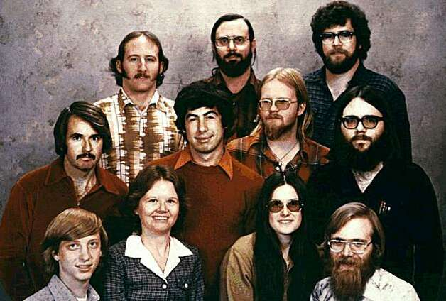 ** FILE ** In this 1978 file photo provided by Microsoft, the 11 people who started Microsoft Corp., are photographed in Albuquerque, N.M., just prior to moving the company to the Seattle area. Shown, top row from left, are: Steve Wood, Bob Wallace and Jim Lane; second row, Bob O'Rear, Bob Greenberg, March McDonald and Gordon Letwin; and front row, Bill Gates, Andrea Lewis, Marla Wood and Paul Allen. Bill Gates, Microsoft's iconic frontman, is finally giving up his full-time gig at the company to devote more time to world health charity work.  (AP Photo/Microsoft, file) Photo: Microsoft, 1978, AP File