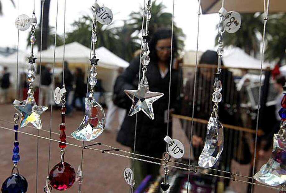 John Ammann sells handmade crystals and other jewelry at a street market on Justin Herman Plaza in San Francisco, Calif., on Saturday, Dec. 11, 2010. Photo: Paul Chinn, The Chronicle
