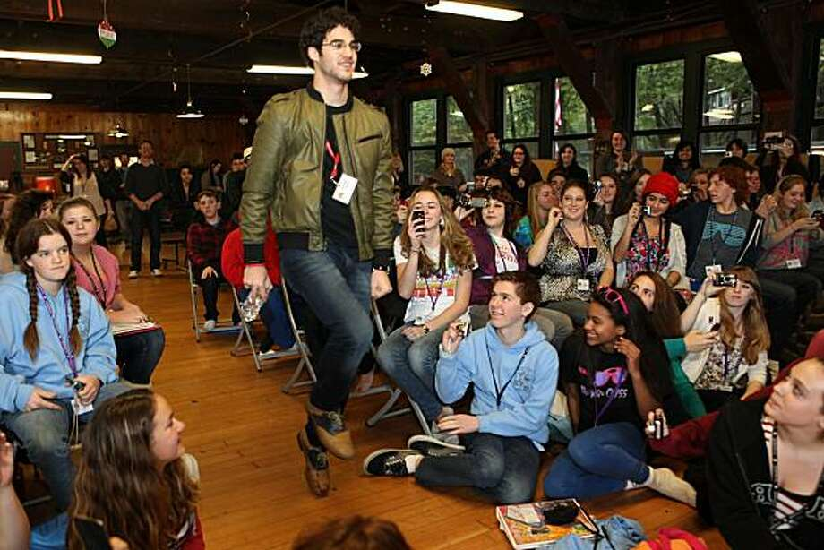 "Glee actor Darren Criss, center, makes an entrance during the Young Actor's Theatre Camp Master's Class at Hayward La Honda Music Camp in La Honda, Calif. on Wednesday, December 29, 2010.   Criss who portrays the openly gay student Blaine, on FoxÕs musical drama series Glee, answered, ""No, I think the characters take on the actors characteristics.""   Kat Wade / Special to the Chronicle Photo: Kat Wade, Special To The Chronicle"