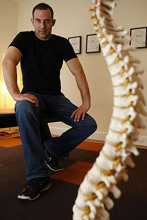 Chiropractor Peter Goldman practices a method called zone healing in San Francisco, Calif., on Tuesday, December 28, 2010. Photo: Liz Hafalia, The Chronicle