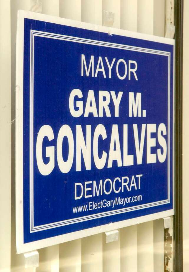 A Gary Goncalves for Mayor sign taped to the window of Democratic Headquarters on Main St. in Danbury Thursday, October 22, 2009 Photo: Carol Kaliff / The News-Times